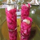 Свечи в лепестках роз