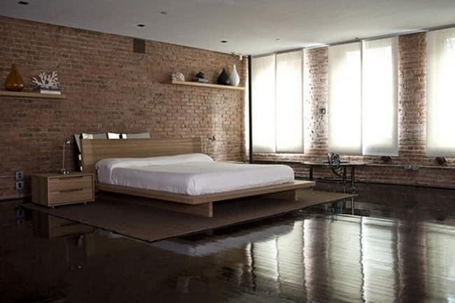 Спальня в лофт стиле с кирпичной кладкой на стенах