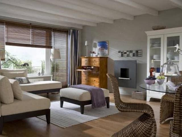 Электрический камин является оптимальным вариантом для гостиных в стандартных квартирах