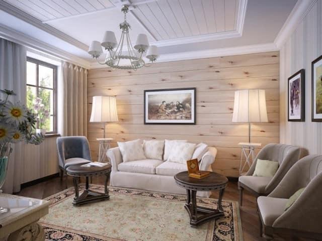 Деревянная стена может выступать в роли фона для картин, рамок для фотографий, настенных часов, портретов