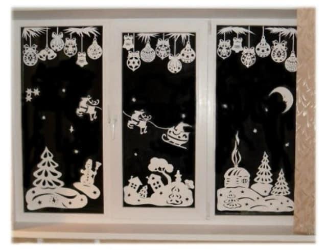 Фигурки из бумаги в новогоднем декоре окна